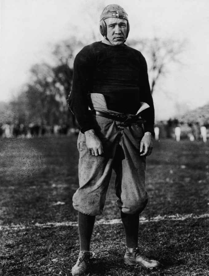 American football player and coach Knute Rockne (1888 - 1931), head coach for Notre Dame, posing in uniform on a field, 1920s. (Photo by Hulton Archive/Getty Images)