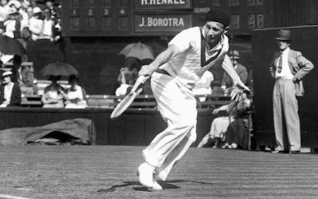 24th June 1935:  French tennis player Jean Borotra in action against H Henkel of Germany on centre court at the Wimbledon Lawn Tennis Championships.  (Photo by H. Allen/Topical Press Agency/Getty Images)