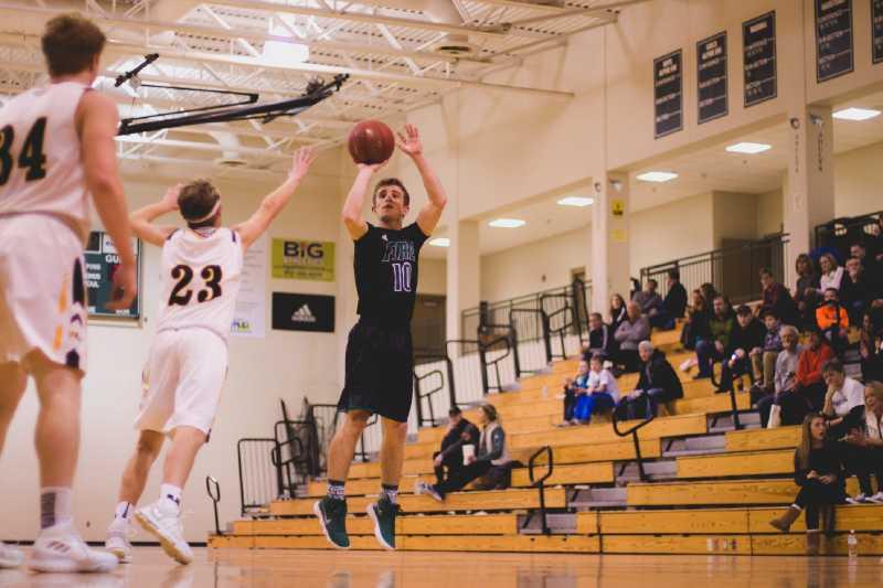 Holy Family Varsity Basketball vs. Hutchinson Jan 26 2018:Lincoln Cizek '18 (10), shoots a 3 pointer.