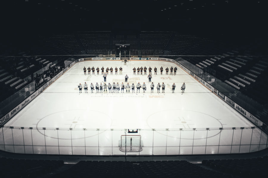Holy Family Varsity Hockey vs Duluth: Both teams line up for the National Anthem