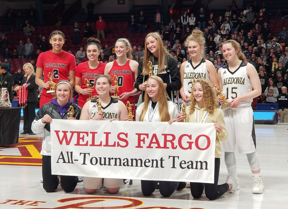 Leigh Steiner (pictured in black) accepting her all-tournament team honors after averaging 16 points per game (20 before injury)