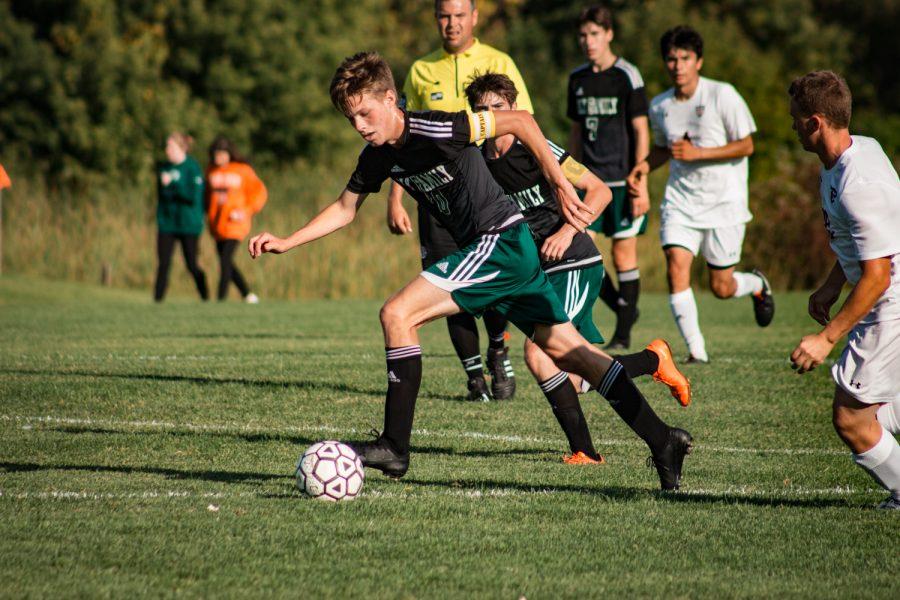 Holy Family Boys Varsity Soccer vs Fargo Shanley 8/6/19: Senior Captain Bennett Creager (10) '20