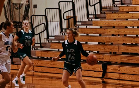 Girls Varsity Basketball vs Heritage Christian Academy  Reagan Cizek (15) '22 and Captain Grace Elander (12) '20