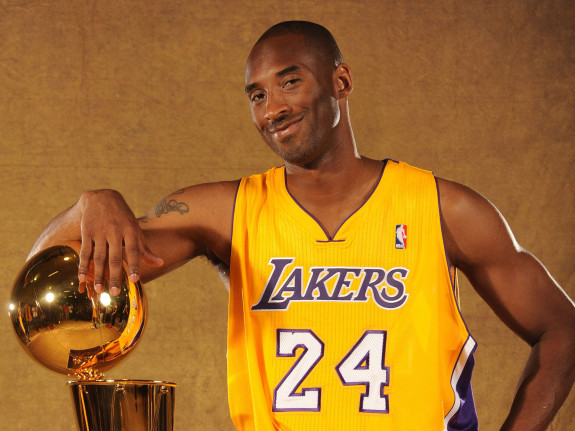 EL SEGUNDO, CA - SEPTEMBER 25:  Kobe Bryant #24 of the Los Angeles Lakers poses with the Larry O'Brien trophy at Media Day at Toyota Sports Center on September 25, 2010 in El Segundo, California. NOTE TO USER: User expressly acknowledges and agrees that, by downloading and/or using this Photograph, user is consenting to the terms and conditions of the Getty Images License Agreement. Mandatory Copyright Notice: Copyright 2010 NBAE (Photo by Andrew D. Bernstein/NBAE via Getty Images) *** Local Caption *** Kobe Bryant