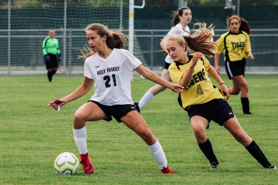 Holy Family's Lauren Rusing '23 (21) during a Wright County Conference matchup against GSL/ Hutchinson High School. Katherine Wise- The Phoenix