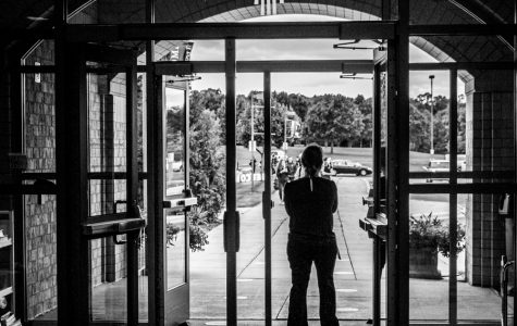 Assistant Principal of Academics, Melissa Livermore stands in the entryway waiting for students to arrive. Collin Nawrocki - The Phoenix