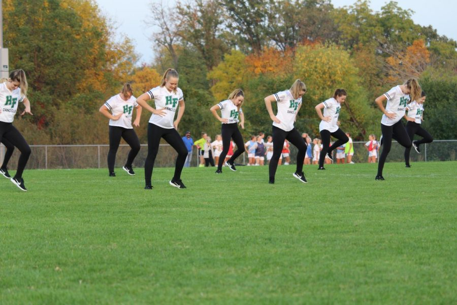 Holy Family Dance Team performing between soccer games.