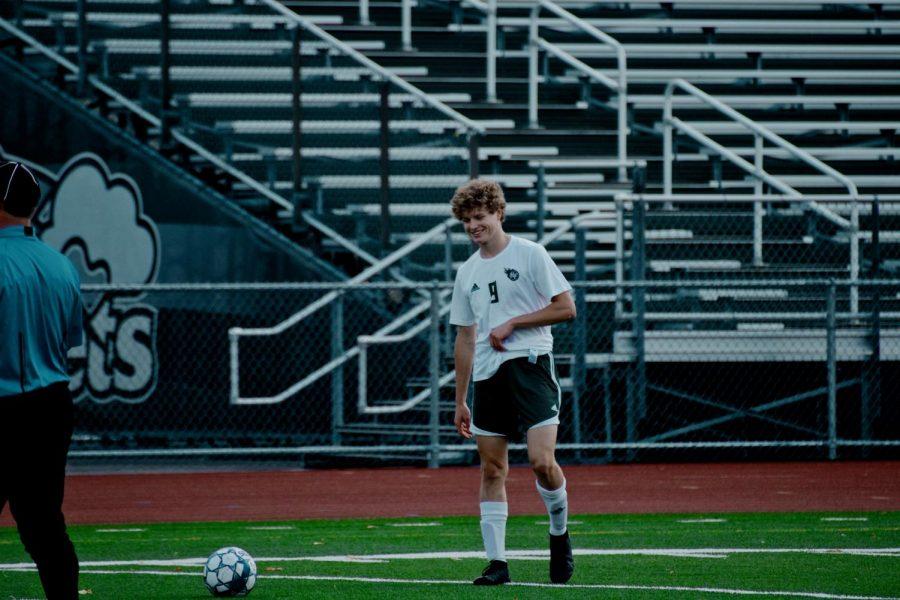 Holy Family's Ryder Ferguson '22 (9) during a game against Rockford High School. Arden Schlegel-The Phoenix