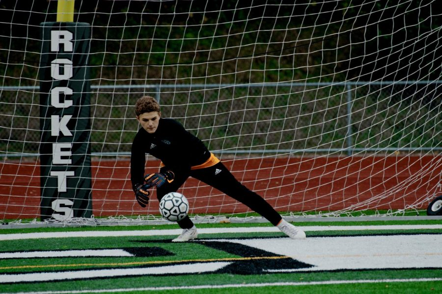 Holy Family's Goalie Dylan Ehlers '22 (1) during a game against Rockford High School. Arden Schlegel-The Phoenix