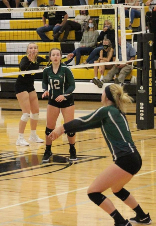 Holy Family's Captain Tatum Hussey '22 (11) receiving the serve from Hutchinson