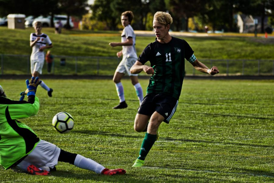 Holy Family's Captain Bishop Schugel '21 (11) during a game against Delano High School. Arden Schlegel-The Phoenix