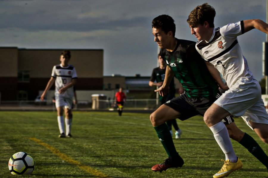 Holy Family's Charlie Ficek '22 (10) during a game against Delano High School. Arden Schlegel-The Phoenix