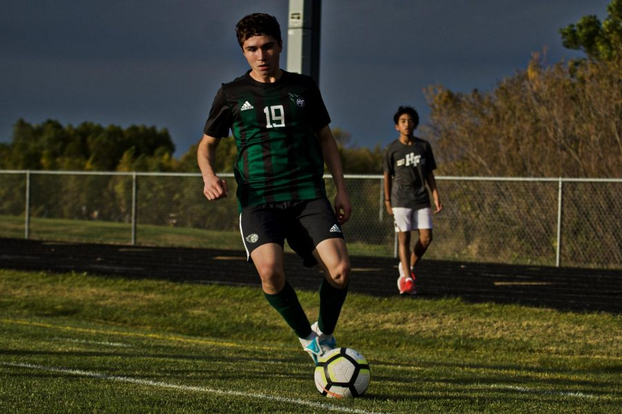 Holy Family's Eric Oconitrillo '23 (19) during a game against Delano High School. Arden Schlegel-The Phoenix
