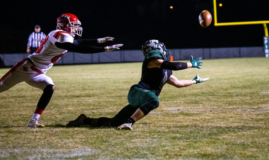 Holy Family's Carver Kasper '21 (11) during a football game where Holy Family fell to Milaca 28-0 on Friday, November 6, 2020 at Holy Family Catholic High School. Collin Nawrocki / The Phoenix