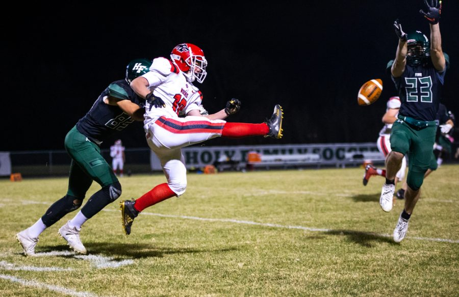 Holy Family's Eddie Diminnie '22 (23) during a football game where Holy Family fell to Milaca 28-0 on Friday, November 6, 2020 at Holy Family Catholic High School. Collin Nawrocki / The Phoenix