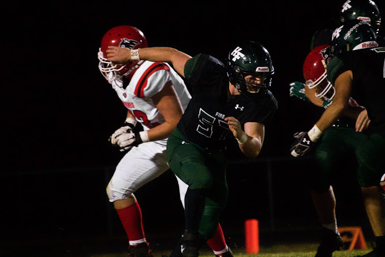 Holy Family's Tyler Pettibone '21 (57) during a game against Milaca