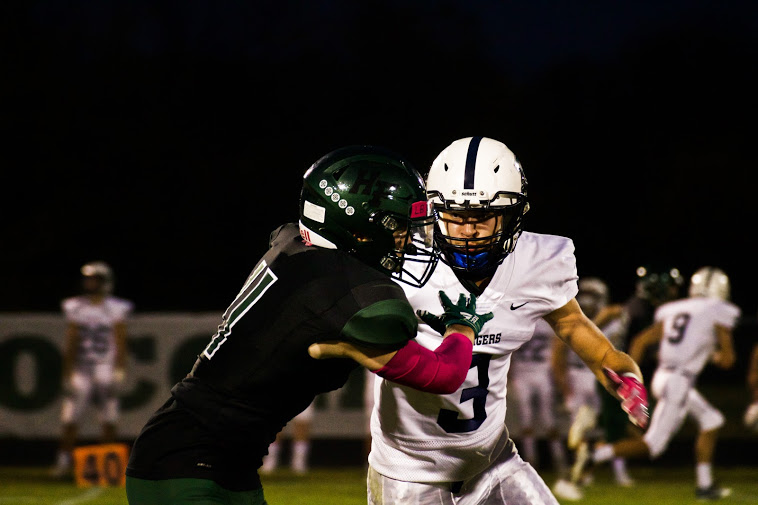 Holy Family's Carver Kasper '21 (11) during a home game against Dassel-Cokato