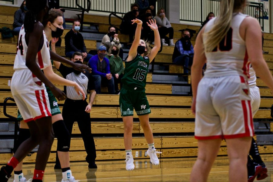 Holy Family's Reagan Cizek (15) '22 during a game against Annandale High School. Arden Schlegel-The Phoenix