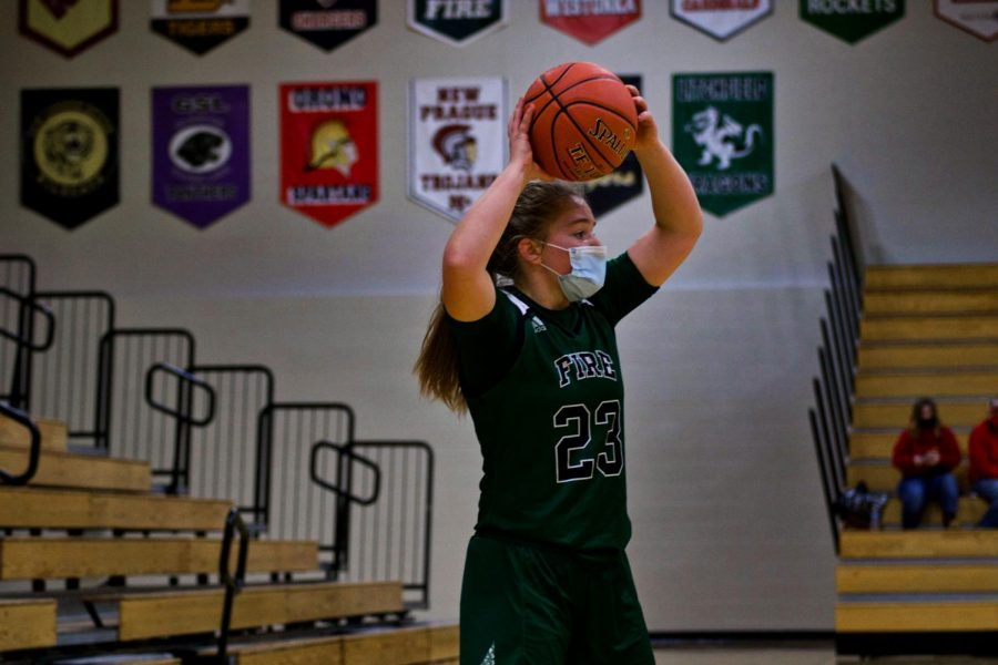 Holy Family Girls Basketball Captain Nicole Bowlin (23) '22 during a game against Annandale High School. Arden Schlegel-The Phoenix