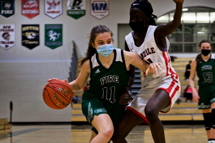 Holy Family's Lauren Weigel (11) '24 during a game against Annandale High School. Arden Schlegel-The Phoenix