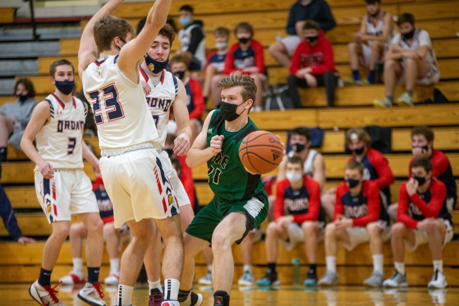 Holy Family's Jacob Warmka '21 (21) during a basketball game versus Orono. The Fire lost the game 82-62 on Friday, January 29, 2021 at Holy Family Catholic High School.