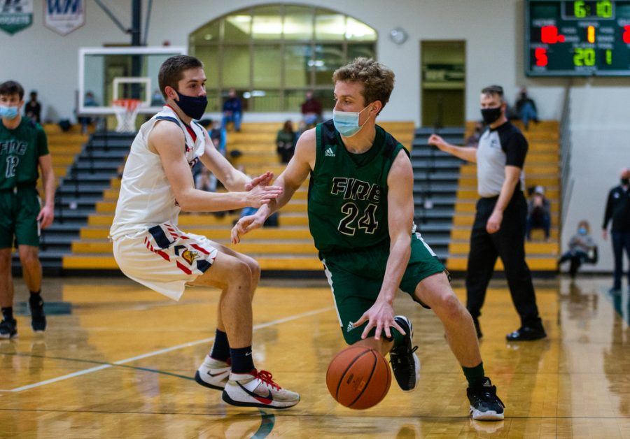 Holy Family's Michael Richelsen '23 (24) during a basketball game versus Orono. The Fire lost the game 82-62 on Friday, January 29, 2021 at Holy Family Catholic High School.