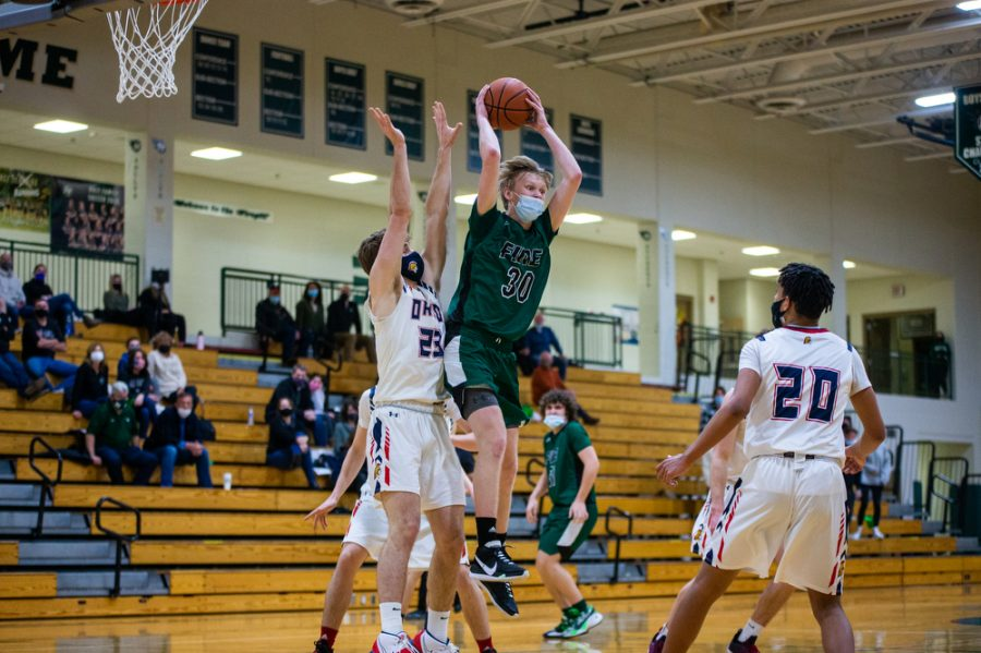 Holy Family's Noah Seck '21 (30) during a basketball game versus Orono. The Fire lost the game 82-62 on Friday, January 29, 2021 at Holy Family Catholic High School.