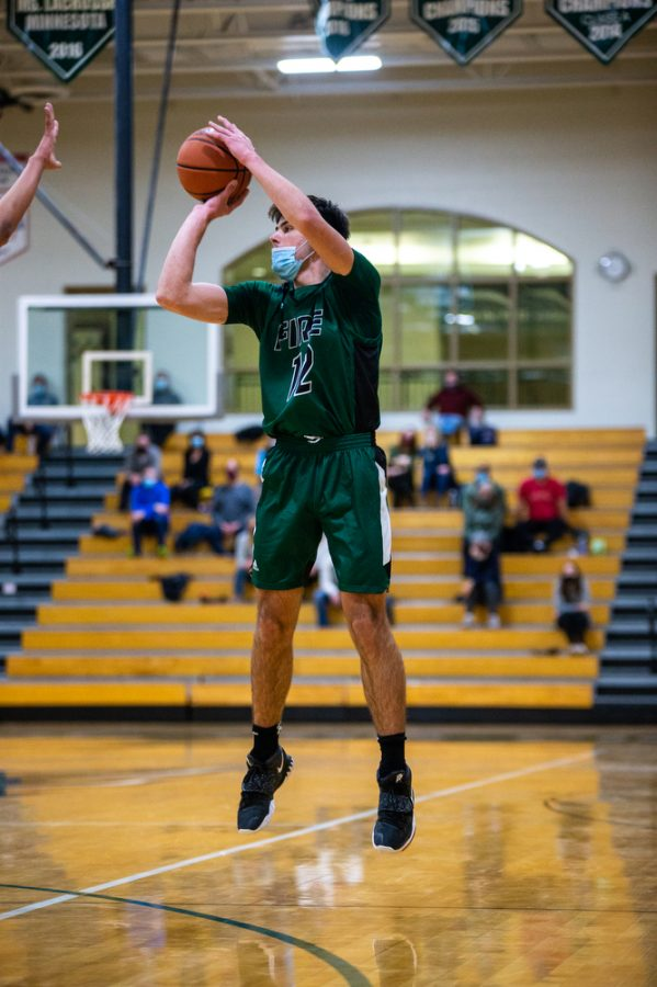Holy Family's Jake Kirsch '21 (12) during a basketball game versus Orono. The Fire lost the game 82-62 on Friday, January 29, 2021 at Holy Family Catholic High School.