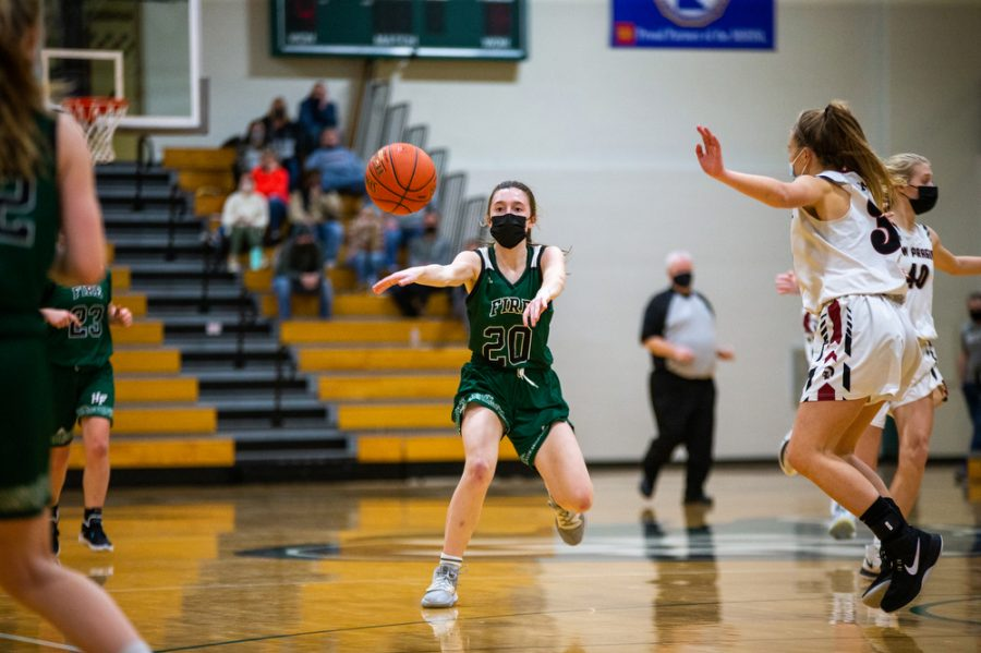 Holy Family's Kate Buchholz '24 (20) during a basketball game versus Orono. The Fire lost the game 77-55 on Tuesday, January 26, 2021 at Holy Family Catholic High School.