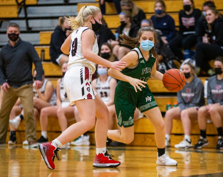 Holy Family's Lauren Weigel '24 (11) during a basketball game versus Orono. The Fire lost the game 77-55 on Tuesday, January 26, 2021 at Holy Family Catholic High School.