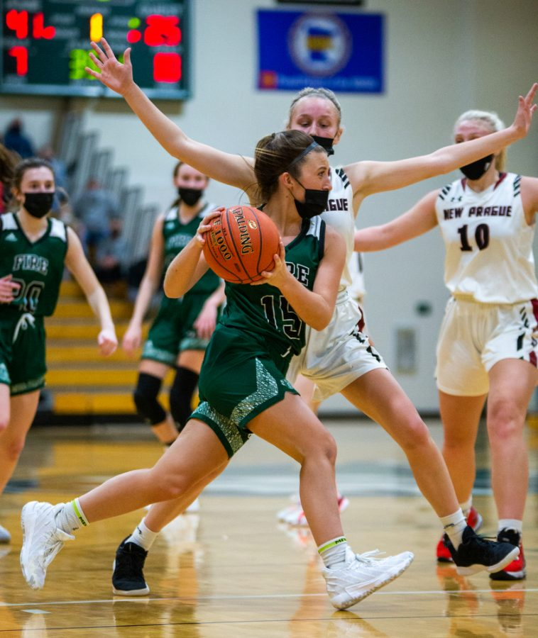 Holy Family's Reagan Cizek '22 (15) during a basketball game versus Orono. The Fire lost the game 77-55 on Tuesday, January 26, 2021 at Holy Family Catholic High School.
