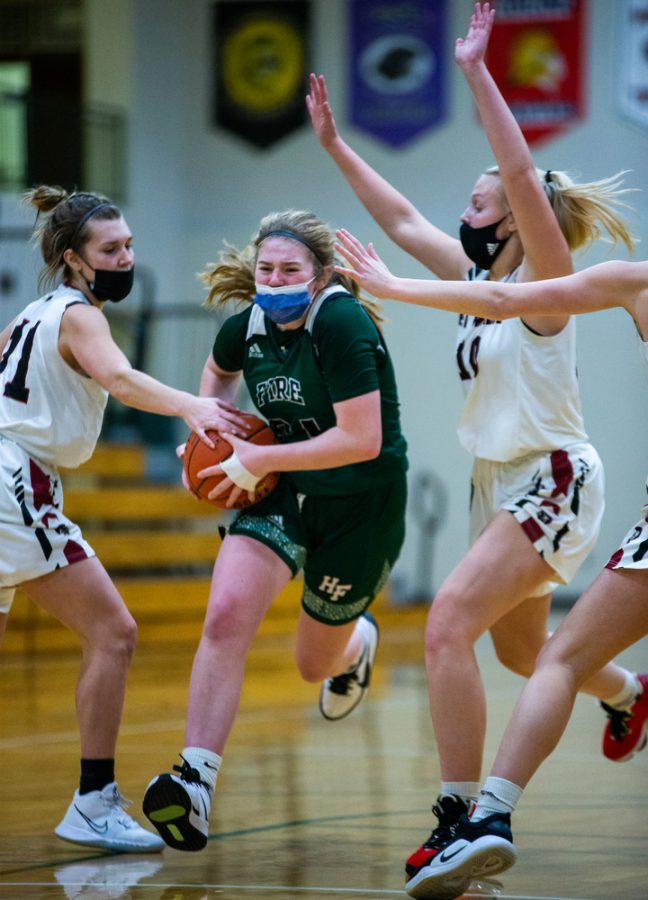 Holy Family's Sophie Zay '24 (24) during a basketball game versus Orono. The Fire lost the game 77-55 on Tuesday, January 26, 2021 at Holy Family Catholic High School.