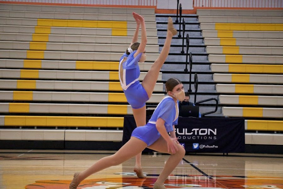 Holy Family Varsity Jazz Dancers Abbey Hope '23 and Rachel Thurk '22 during a Tri-Meet at Delano High School. Arden Schlegel-The Phoenix