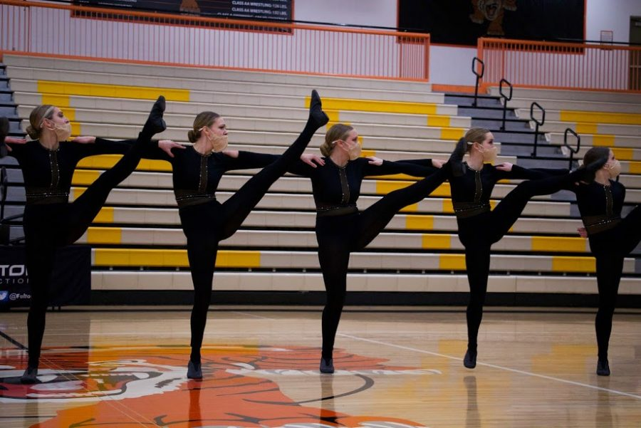 Holy Family Varsity Kick Dancers during a Tri-Meet at Delano High School. Arden Schlegel-The Phoenix
