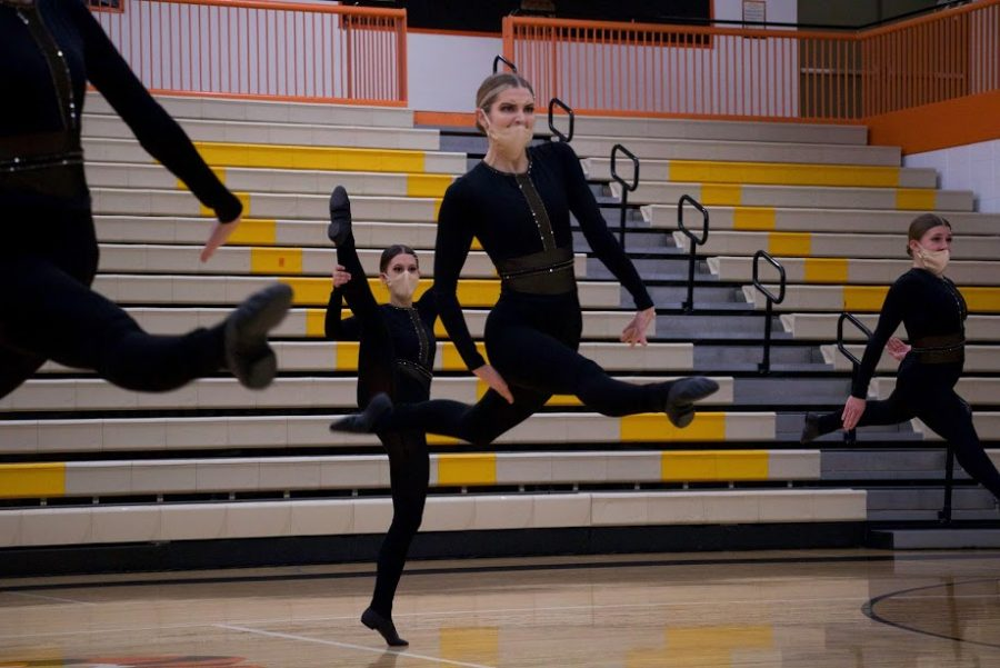 Holy Family Varsity Kick Dancer during a Tri-Meet at Delano High School. Arden Schlegel-The Phoenix