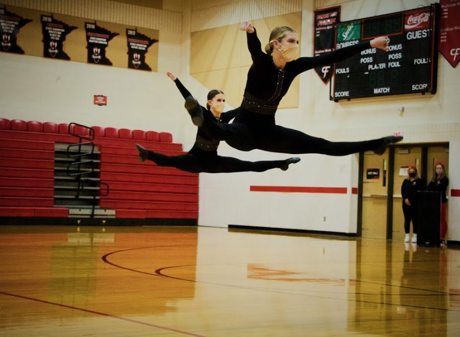 Holy Family Varsity Kick Dance Team's Jordan Flink '21 and Olivia Sadowski '22 during a competition at Cannon Falls High School. Arden Schlegel-The Phoenix