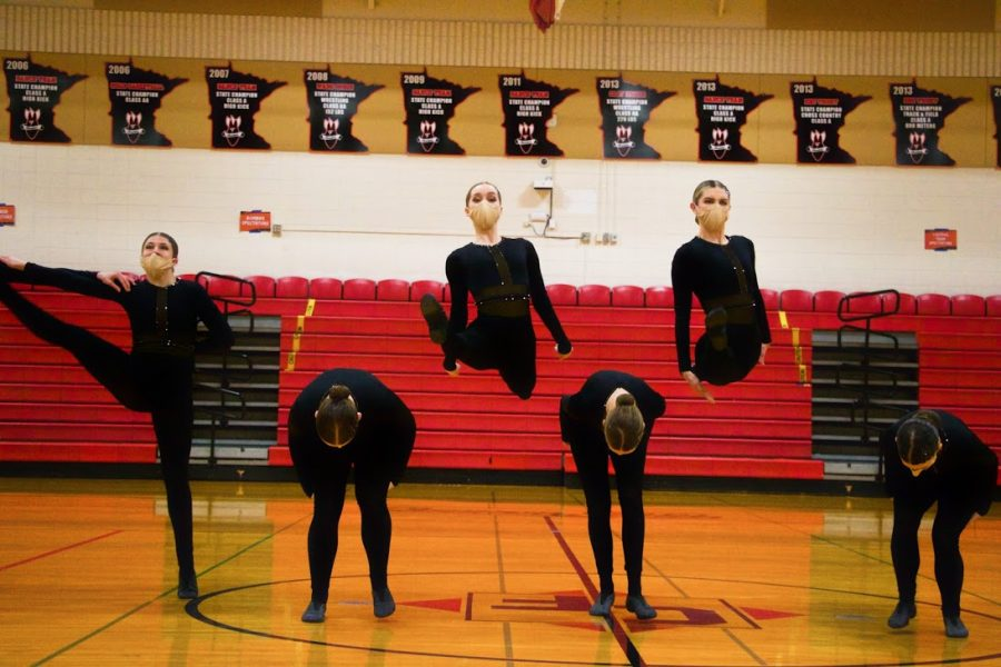 Holy Family Varsity Kick Dance Team during a competition at Cannon Falls High School. Arden Schlegel-The Phoenix