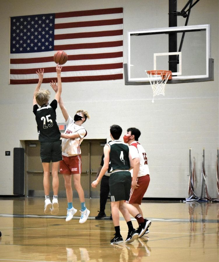 Holy Family A Basketball Team vs Mound Westonka. Photographer Lily Schaffer for The Phoenix
