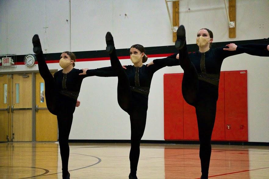 Holy Family Varsity Kick Dance Team-Abbey Hope '23, Jordan Flink '21, and Ryley Covington '22-Arden Schlegel The Phoenix